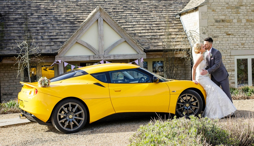 A beautiful MorLove photograph taken at Hyde Barn. The groom arrived in an amazing yellow Lotus supercar.