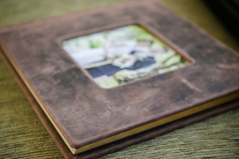 Rustic brown leather wedding album with cameo window.