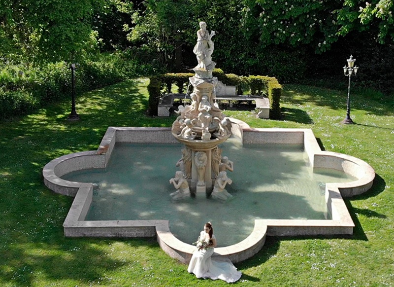 An aerial photograph showing a fountain and bride