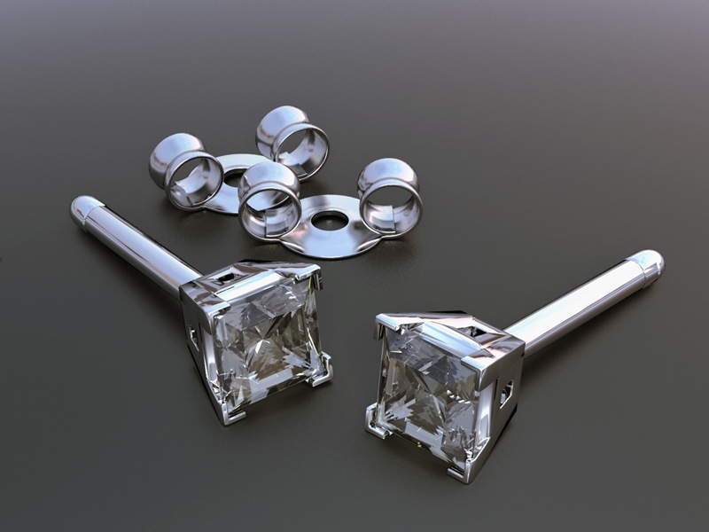 A 3D graphic of a silver diamond earrings