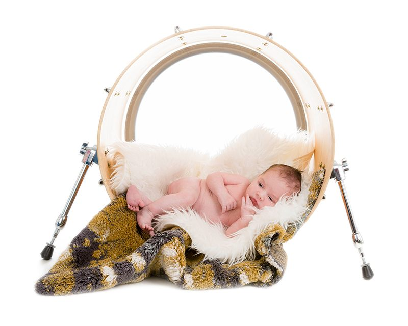 A newborn baby inside a musical drum