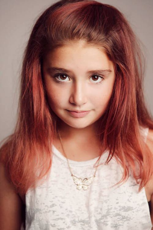 A portrait shot of a red haired girl