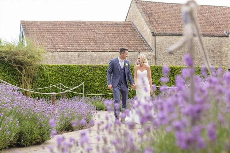 A wedding photograph taken waist up shot of couple in lavender