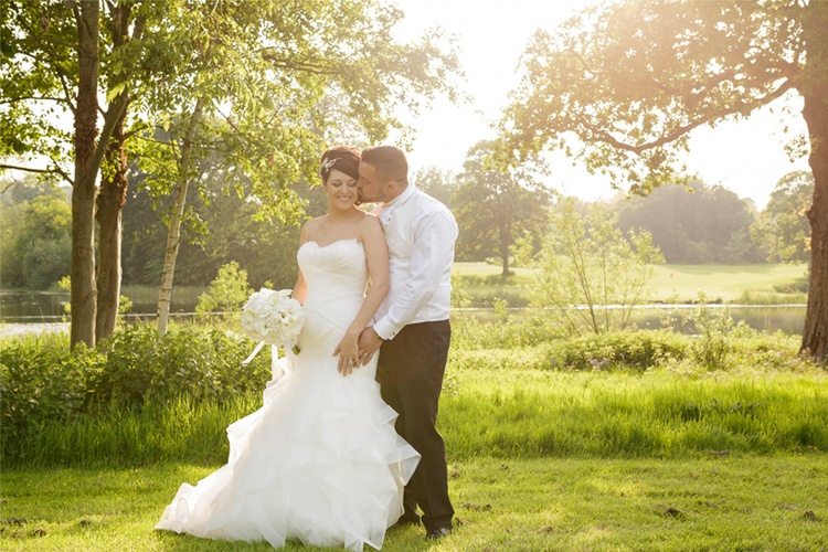 Wedding photograph taken at St.Pierre of couple with evening sunlight